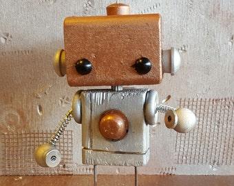 C.U.R.L.Y. wooden robot