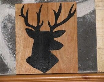 Framework of wood, deer head