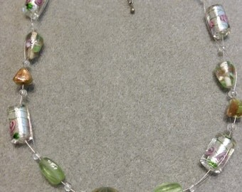 Delicate green and gold necklace.