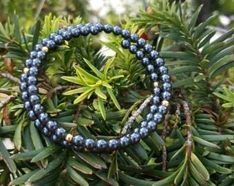 Bracelet of Hematite with Golden beads