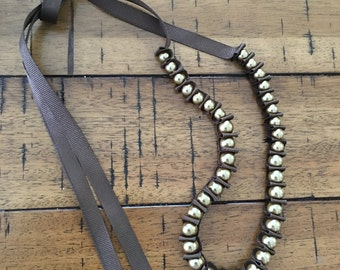 Brown and gold pearl and ribbon necklace