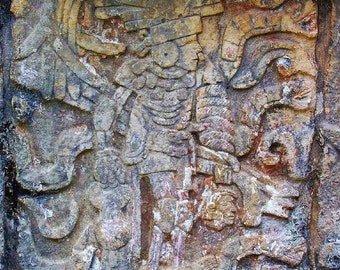 Victorious. Maya Warrior Carrying Decapitated Head. Stone Relief. Yucatan, Mexico.