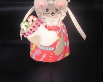 Christmas Mouse holding a Christmas Stocking