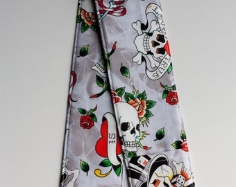 Camera Strap Cover - includes padding and lens cap pocket - Ed Hardy