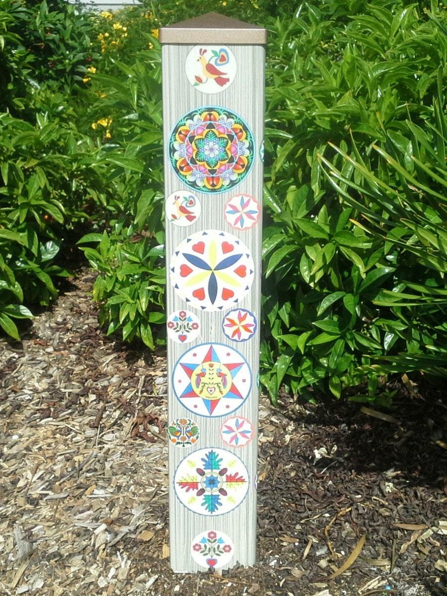 Garden art peace pole hex signs for Garden art pole