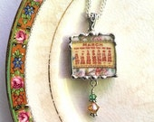Broken china jewelry pendant necklace March birthday 1921 calendar plate with Swarovski crystal drop