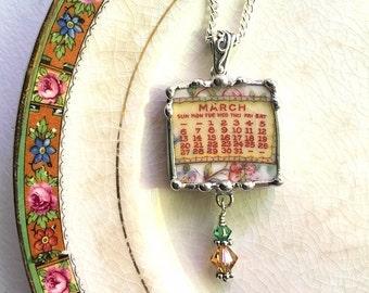 Broken china jewelry pendant necklace March birthday 1921 calendar plate with Swarovski crystal drop