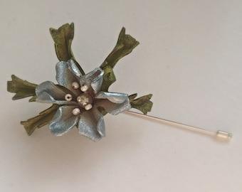 Silvery-blue flower pin