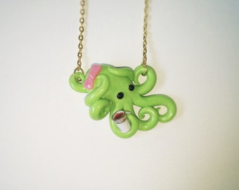 Tea time, green octopus necklace with pink bow, pastel, semi translucent, opalescent, sparkly, glitter,