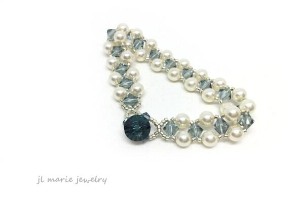 something blue bracelet . cream pearl and blue crystals .  bracelet . bridal . for the bride . wedding day bracelet