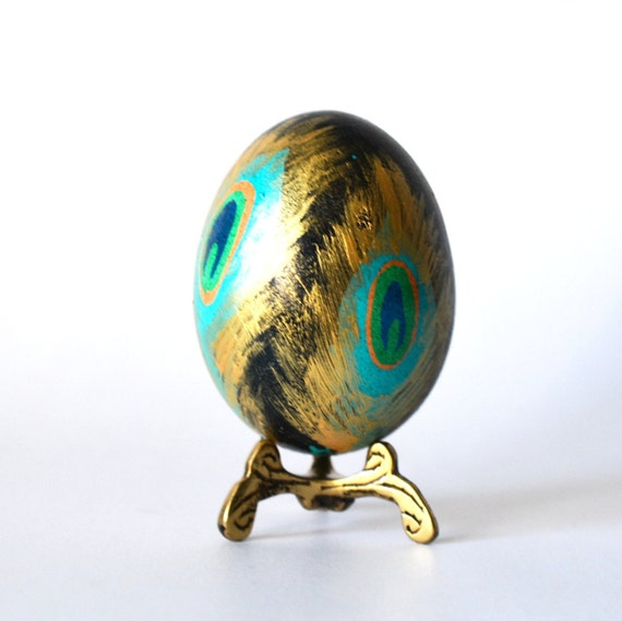 Peacock feathers goldleafed on chicken egg pysanka