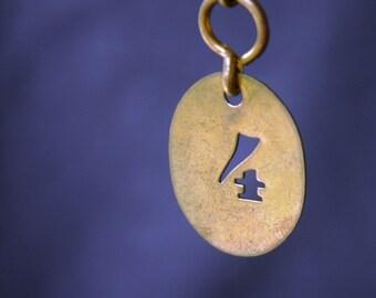 Vintage 4 numbered golden tag.