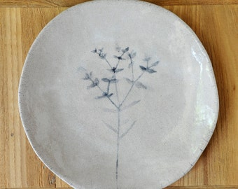 A pair of hand-made and hand-painted ceramic plates