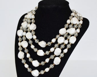 Vintage Necklace with Four Strands of Pearl Plastic and Clear Beads and Small Metal Beads