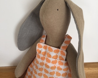 Handmade cute fabric rabbit girl - dressed in an orange and off white cotton pinafore dress