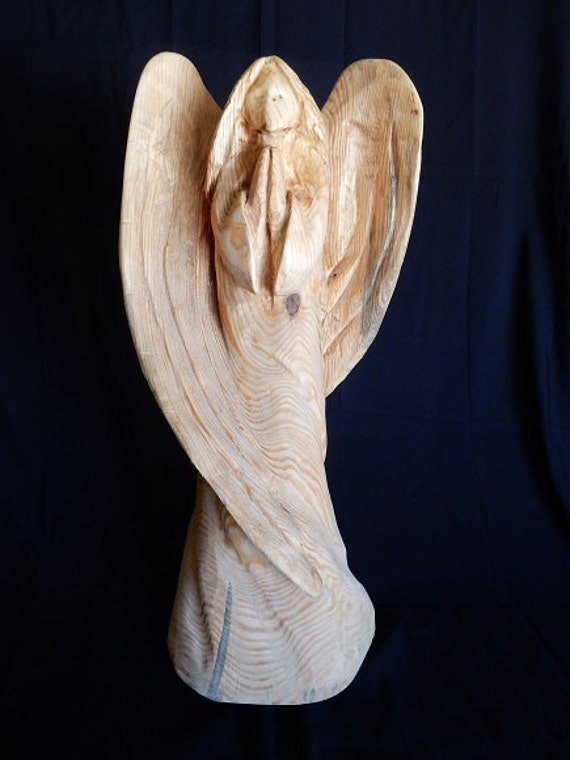 Chainsaw carving praying angel