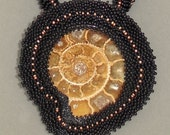 A beadwork necklace with a shell fossil