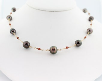 Reserved for M Cherry Tahitian pearl necklace, garnet gemstones, saltwater, black pearls, tin cup, circle, handcrafted, gold: Simply Adorned