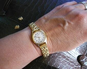 Gold Pulsar watch.  Vintage.  Ladies wrist watch.  Extra links.