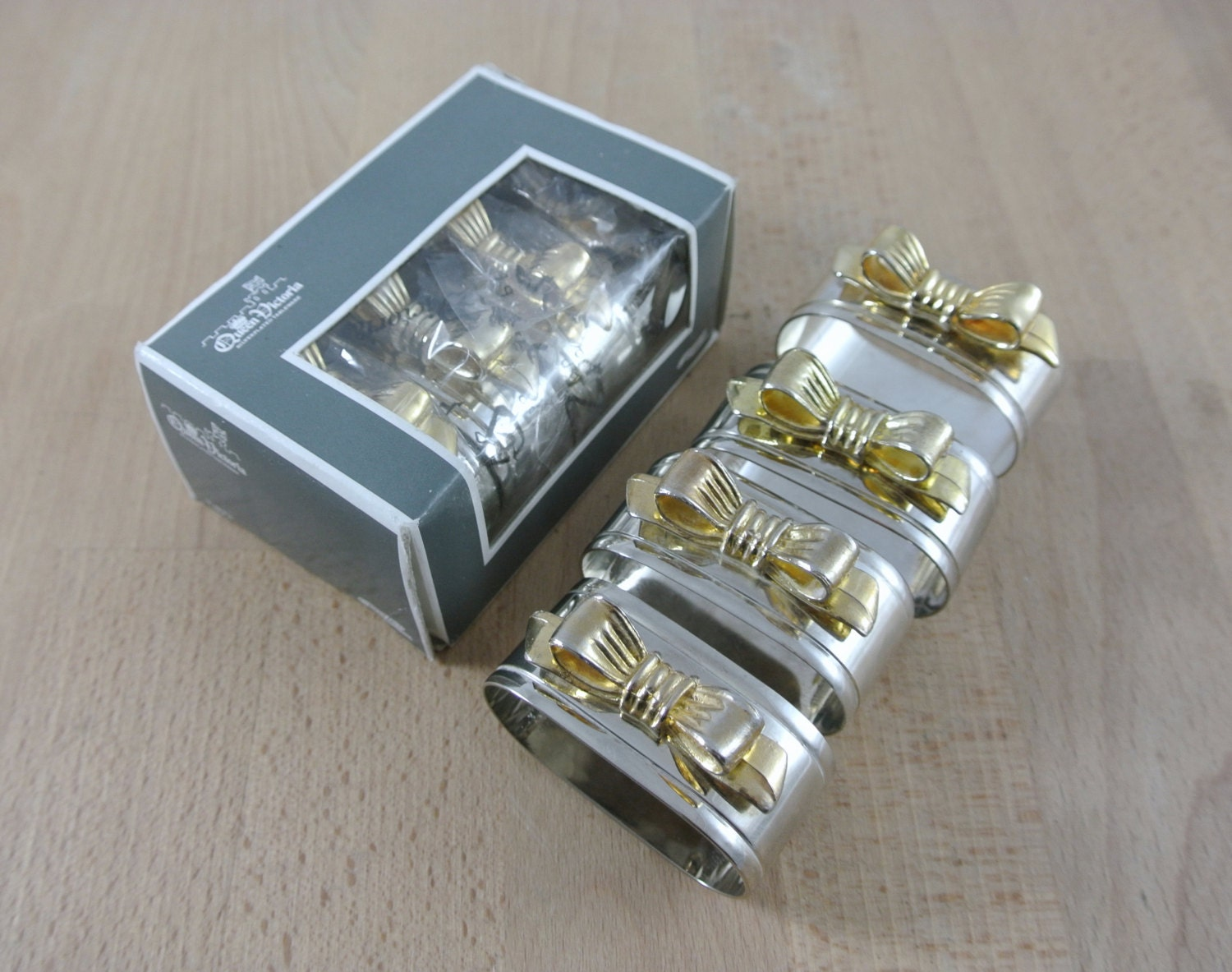 vintage silver plated napkin rings with gold bows set of 8