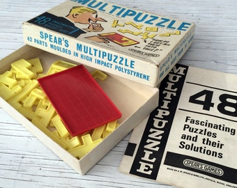 Multipuzzle vintage game from Spear games. 48 puzzles in one. Made in Enfield, England.