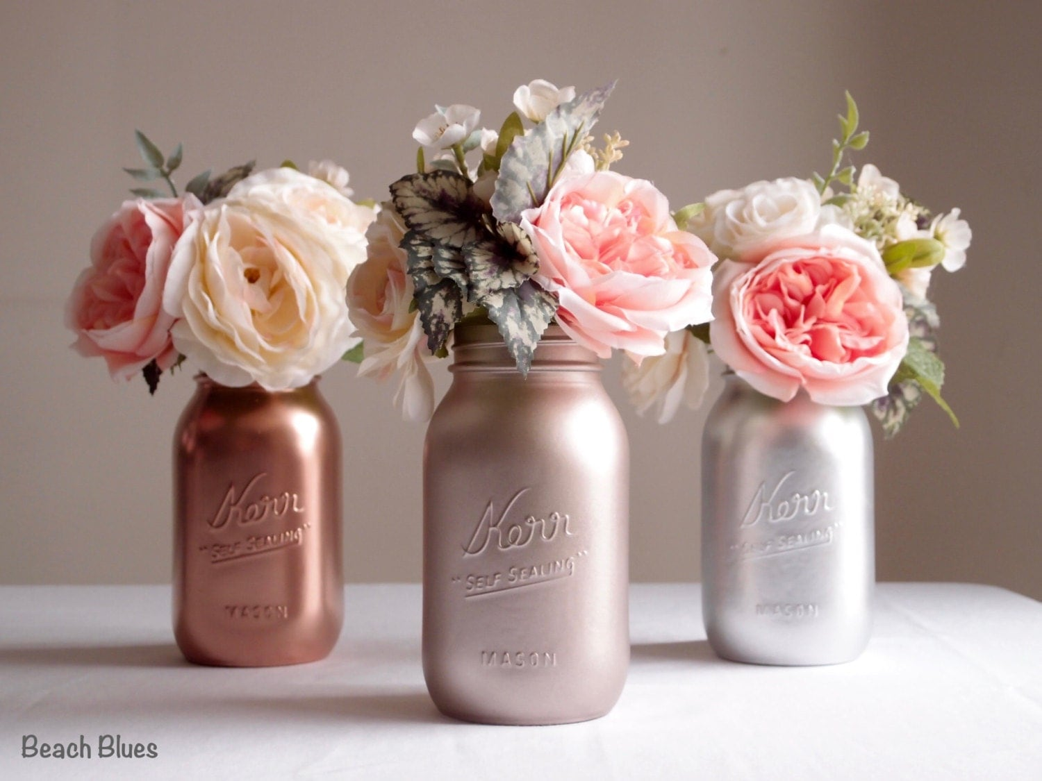 Rose gold wedding mason jars centerpiece by