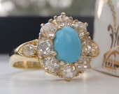 A Stunning Halo of 1.15 Carats of Plump Old European Diamonds Surrounds A Pretty Cabochon Turquoise. Statement Vintage Engagement Ring.