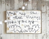 Smallest things take up the most room in our hearts black and white rustic wood sign