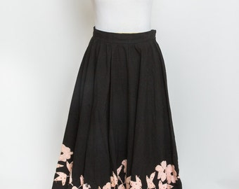 Tee length black vintage skirt