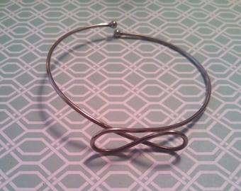 Bow Arm Cuff Bracelet in Silver Tone