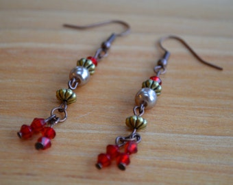 Intricate red, gold and antiqued bronze beaded earrings