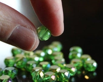 30 glass electroplated 8 mm beads, flat round, faceted around edges, one side frosted, green