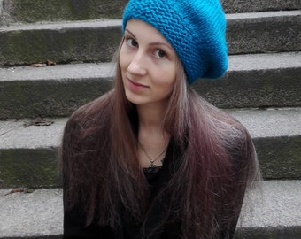 Knitted warm blue beret for women