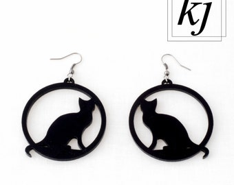 "Couple of earrings ""Cats"" in shiny black plexiglass."