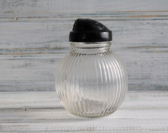 Hazel Atlas Vertical Ribbed Ball Shaped Pepper Shaker with Black Lid