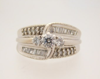 1.00 Carat T.W. Round & Baguette Cut Diamond Cluster Ring14K