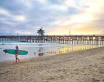 Girl Surfer San Clemente,Pier,, Beach, So California, Sunset,Blues,Amber yellow ,Old Pier,Seaside Life