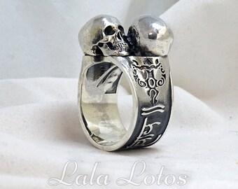 Om Namah Shivaya nielloed silver ring featuring mantra and a couple of skulls.