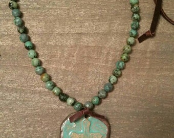 FREE SHIPPING!  Clay cast cross framed in a hand soldered bezel pendant on african turquoise beads and suede lace necklace