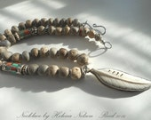 Wise woman's talisman necklace: Enduring, strong, focused.