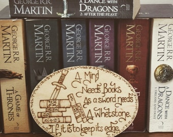 """Game of Thrones, Tyrion Lannister Quote Pyrography  Sign - """"A mind needs books as a sword needs a whetstone. If it is to keep its edge."""""""