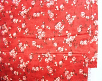 PRICE REDUCED---Red cotton fabric with white/cream roses.  Over 2 yards.  14 oz.