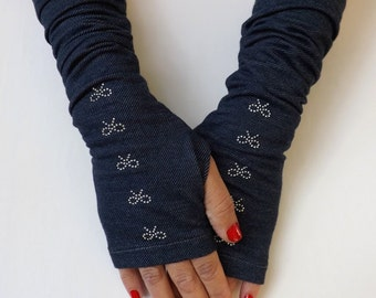 Denim blue jersey fingerless gloves. Elastic jersey gloves decorated with Swarovski crystal bows. Long mittens