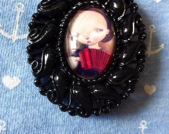 Strange child resin brooch