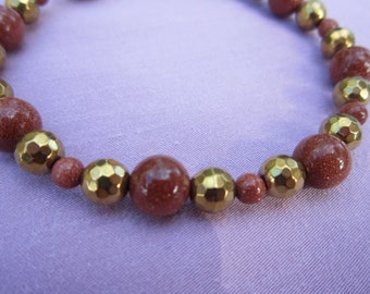 Goldstone and faceted brass bead bracelet