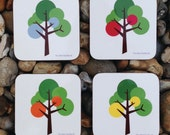 Scandinavian inspired cork coaster set drink coaster set in modern tree pattern with grey green red yellow orange accent colour