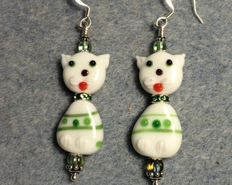 White and green lampwork cat bead earrings adorned with a rhinestone collar and green Czech glass beads.