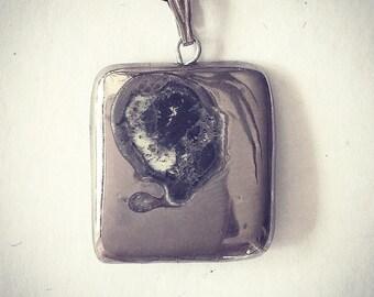 Silver square pendant.