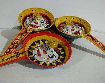 Trio of Vintage Tin Clown Noise Makers