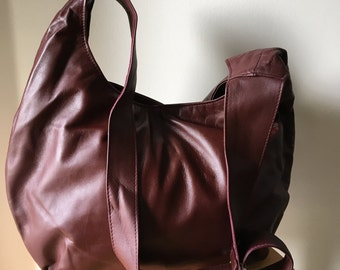 Hobo slouch genuine leather handbag tote. Uniquely shaped and is a classic shopping tote. Large genuine leather tote bag, hobo style purse
